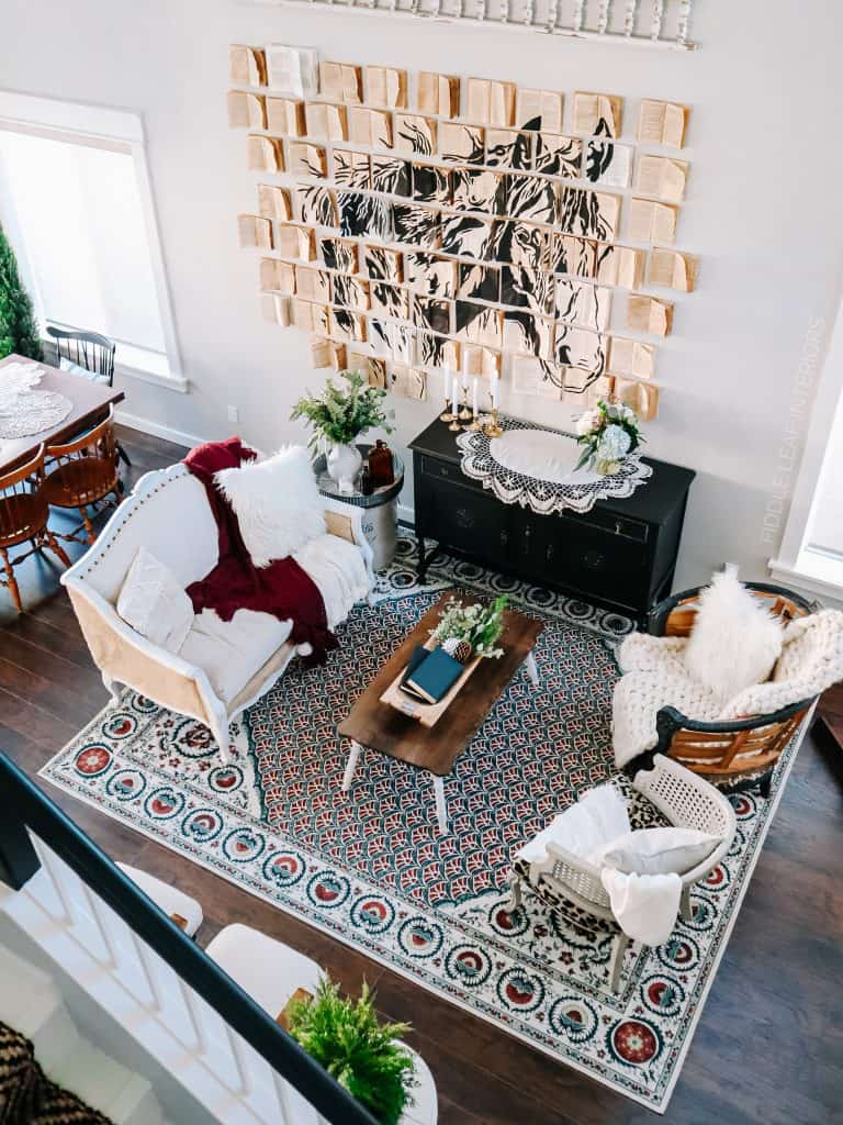 ruggable rug in living room with book wall art of horse on wall | fiddle leaf interiors