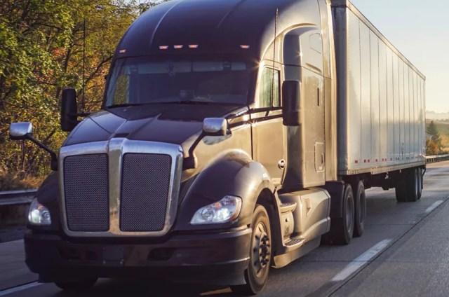 semi truck driving down the road