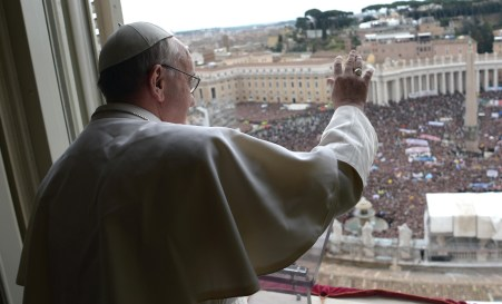 Newly elected Pope Francis appears at the window of his future private apartment to bless faithful during Angelus prayer at Vatican
