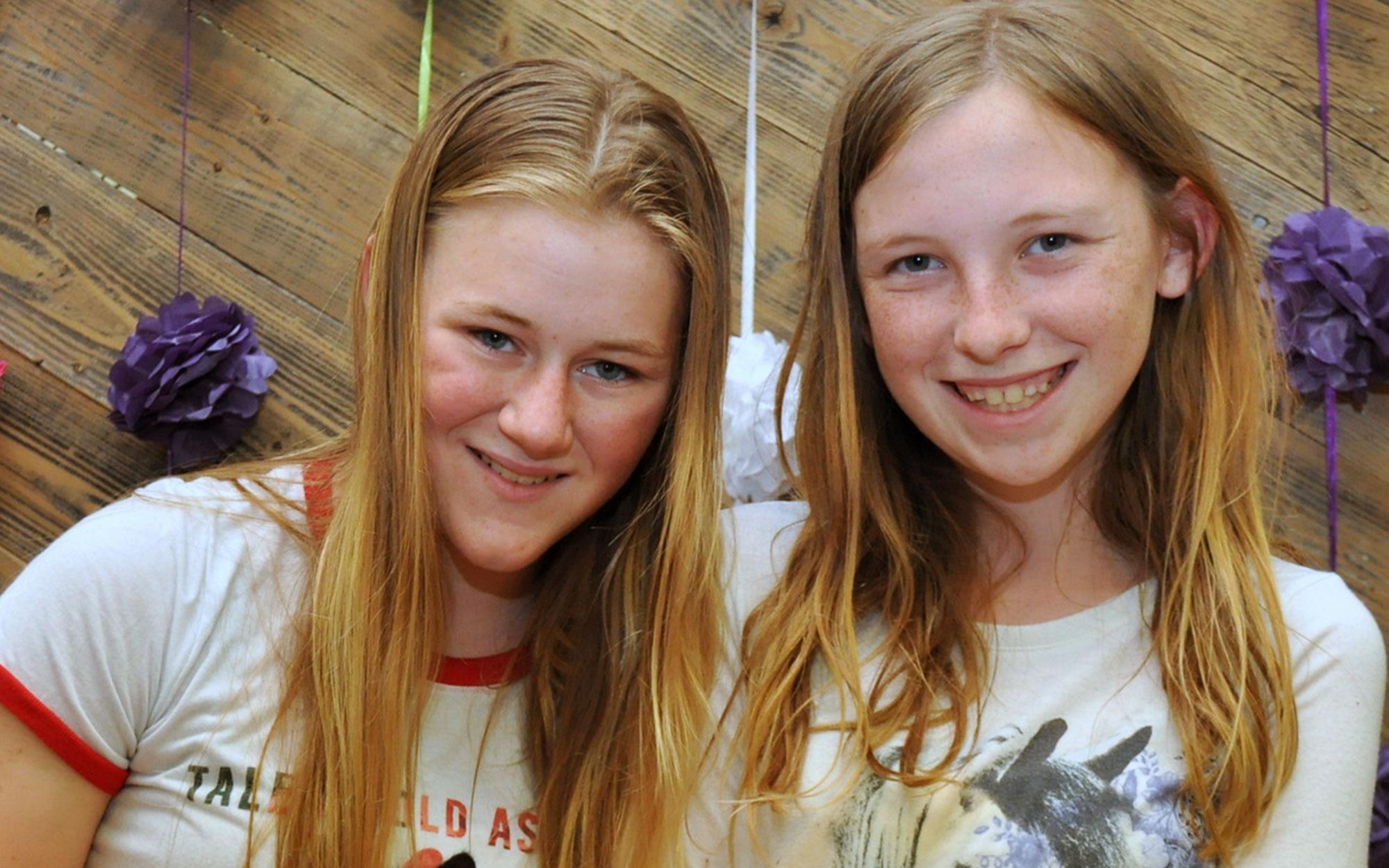 Two smiling volunteers