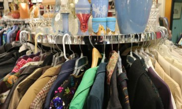 A clothing rack inside of FieldHaven Marketplace.