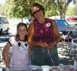 Mom and daughter volunteers spending time outside.
