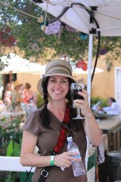 A guest at Classics, Cats & Cabernet enjoying wine.