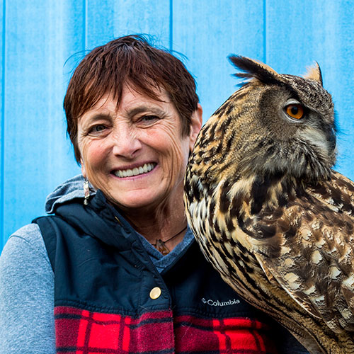 Board member Kate Marden holding an owl