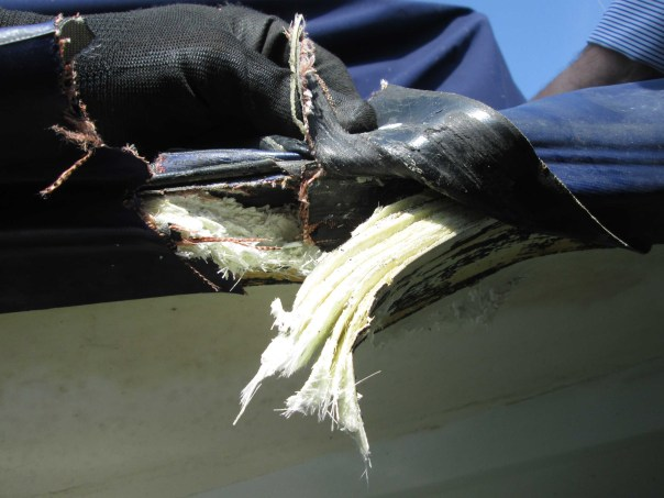 Damage to hull, deck and sponson of GRP RIB after side impact from sailing dinghy