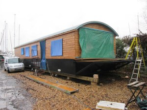 New build survey of steel houseboat at Dell Quay Yacht Yard, Chichester