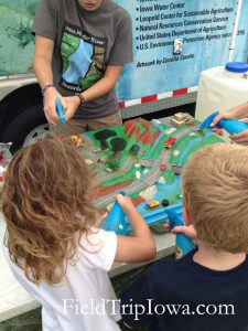 Iowa State Fair WaterRocksISU kids making a rain storm