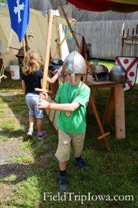 My boy tries on a helment at Medieval & Renaissance Society at the Renaissance Faire at Sleepy Hollow