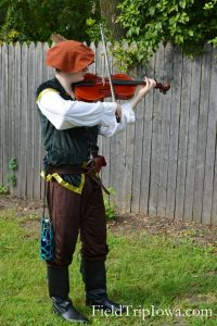 Man plays the violin at the Renaissance Faire at Sleepy Hollow
