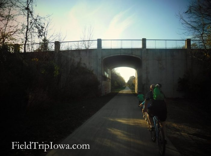 bikers riding to tunnel on High Trestle Trail Bridge Trail