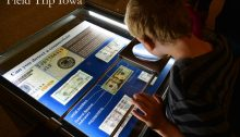 Child looks at money in the Money Museum in Kansas City