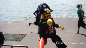 Man dressed in Lego costume as part of Pirates Cove live ski show at Legoland Florida.