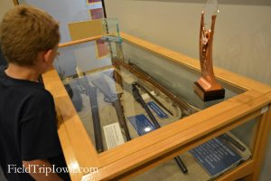Child looks into a gun display in the Fort Davidson museum in Arcadia Valley Inronton Missouri