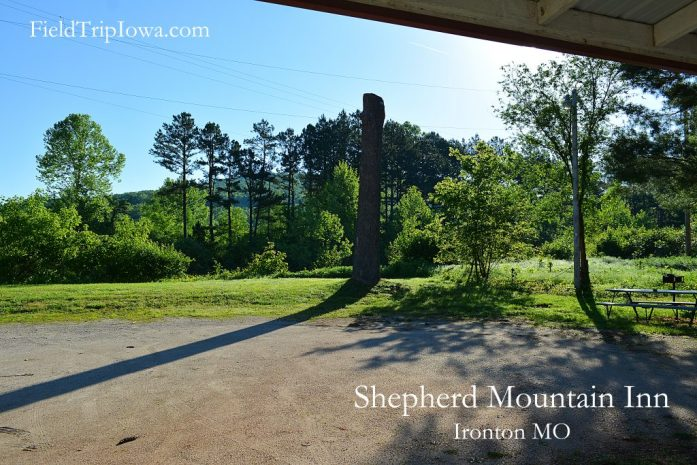 Backyard sunny morning view of trees and mountain at Shepherd Mountain Inn in Ironton MO