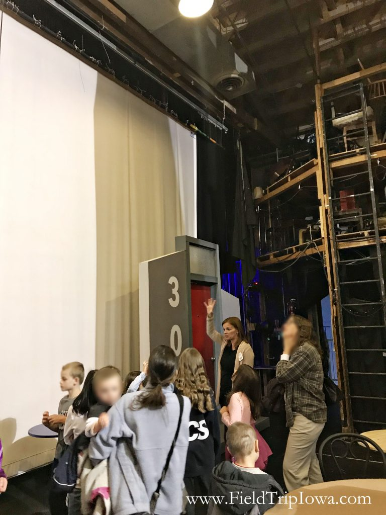 Student on a backstage on the Des Moines Community Playhouse tour in Iowa.