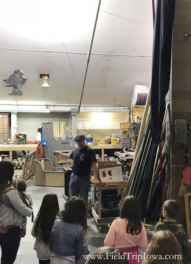 Students learn about the workshop on the Des Moines Community Playhouse tour in Iowa.