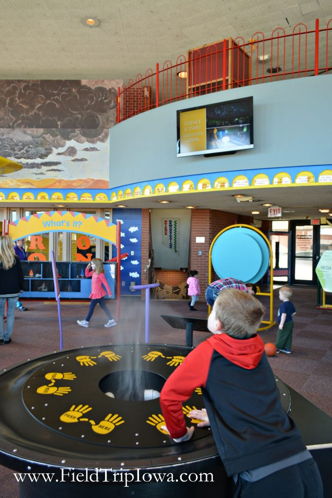 Boy explores in Bluedorn Science Imaginarium in Waterloo Iowa
