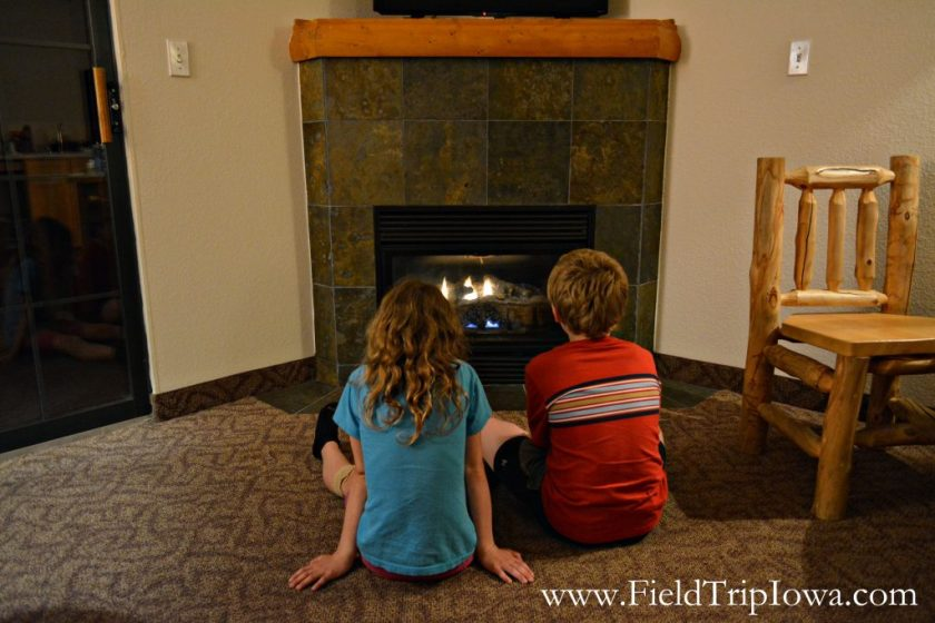 Children sitting in front of fireplace at Grizzly Jack's Grand Bear Resort and Indoor Waterpark in Utica, IL