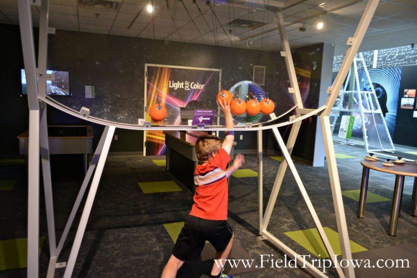 Boy moves balls in Putnam Museum in Quad Cities.