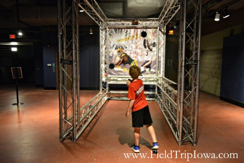 Boy throws football in vertiual display at Putnam Museum in Quad Cities.