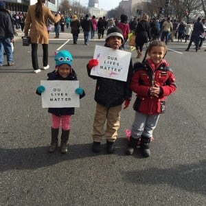 """Saa Nassel, 3, Jayelin Robinson , 6, and Liliana Wheeler, 5, with signs saying """"Our Lives Matter"""" at the Justice for All March. (Photo courtesy of Kenrya Rankin Nassel)"""