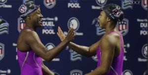 Screen shot of Olympian Lia Neal, right, celebrating with her Stanford teammate and friend, Simone Manuel, as the first two black women on the U.S. swim team.
