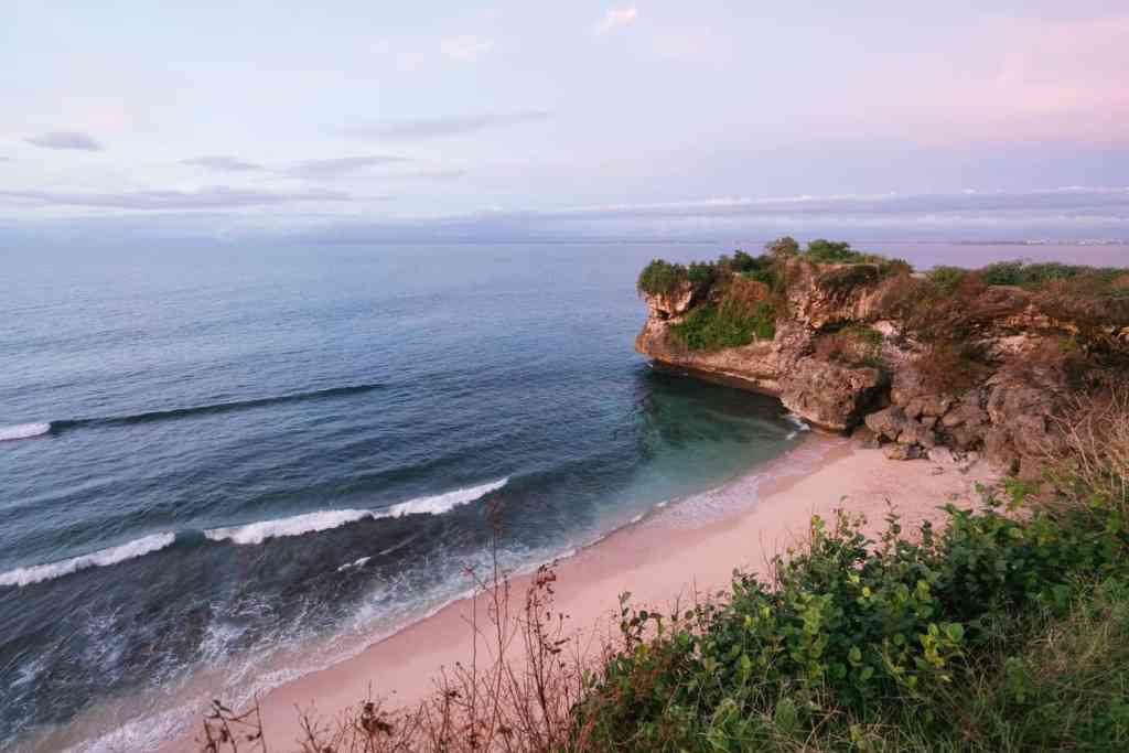 amazing view of beach with rocky cliff