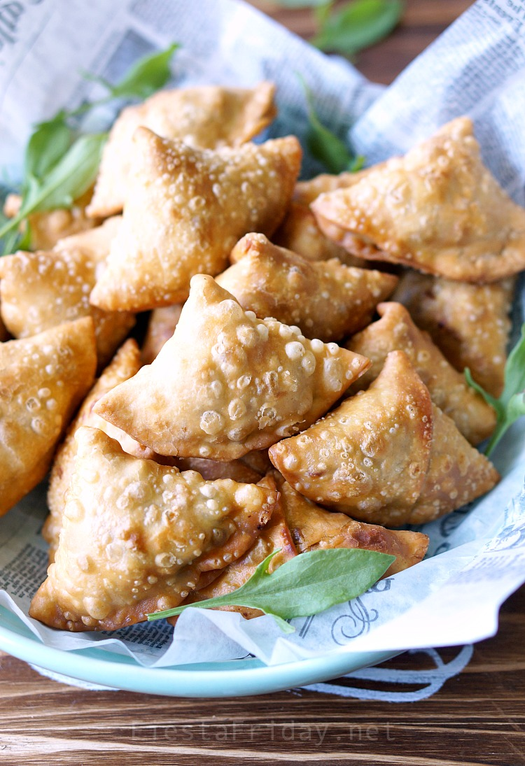 Crunchy Samosas | These are not your usual samosas. Filled with rhubarb and sorrel that lend their tart flavor, along with the more traditional potatoes and peas, they are downright spectacular! #samosas #Indian #appetizer #rhubarb #sorrel #fiestafriday