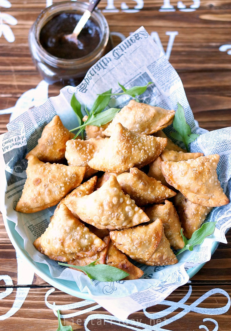Spectacular Samosas | These are not your usual samosas. Filled with rhubarb and sorrel that lend their tart flavor, along with the more traditional potatoes and peas, they are downright spectacular! #samosas #Indian #appetizer #rhubarb #sorrel