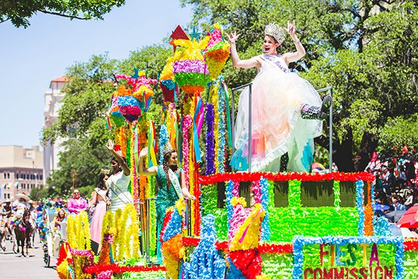 "Miss Fiesta San Antonio Madi Moad-Hageman signs ""I Love You"" to the crowd during the 125th Fiesta San Antonio."