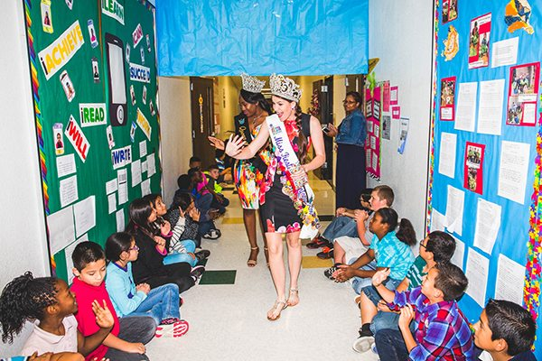 Official Fiesta Royalty visit San Antonio school children during Fiesta San Antonio. Here Miss Fiesta and Queen of Would visit students during the 125th Fiesta San Antonio.