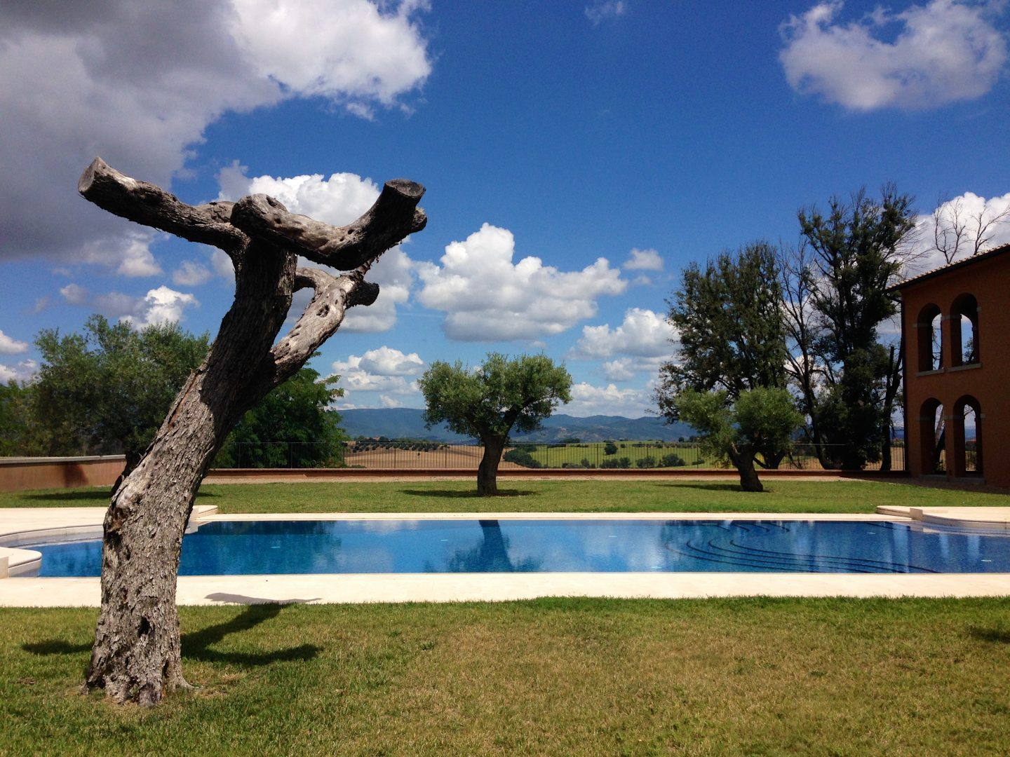 Chilling poolside at Villa Loggia winery in Cortona Tuscany.