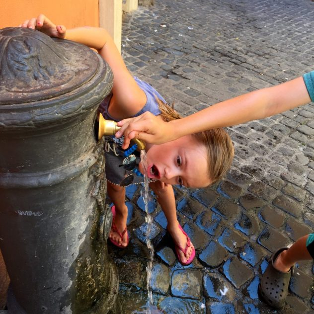 Drinking out of the water fountain in Rome.