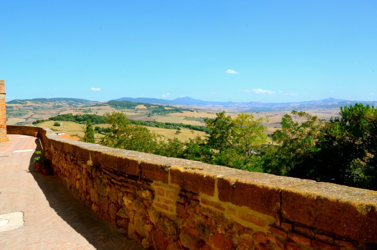 Walk on the path that circles around Pienza Tuscany.