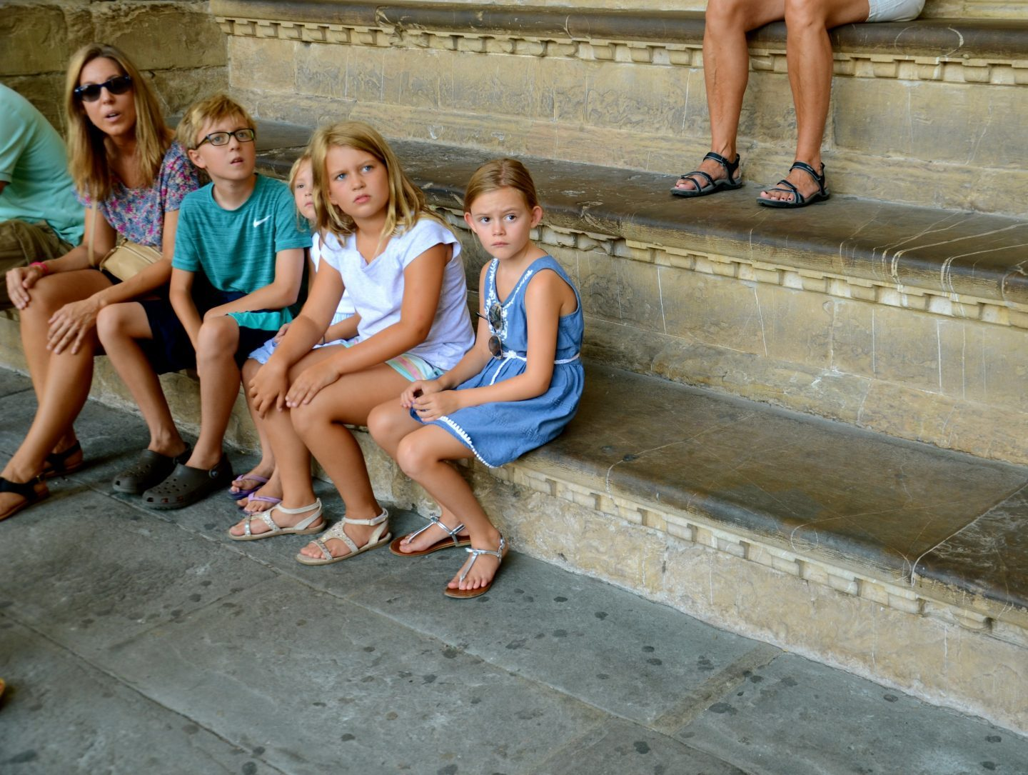 Sitting up the steps for a break in the pizza della signoria in Florence.