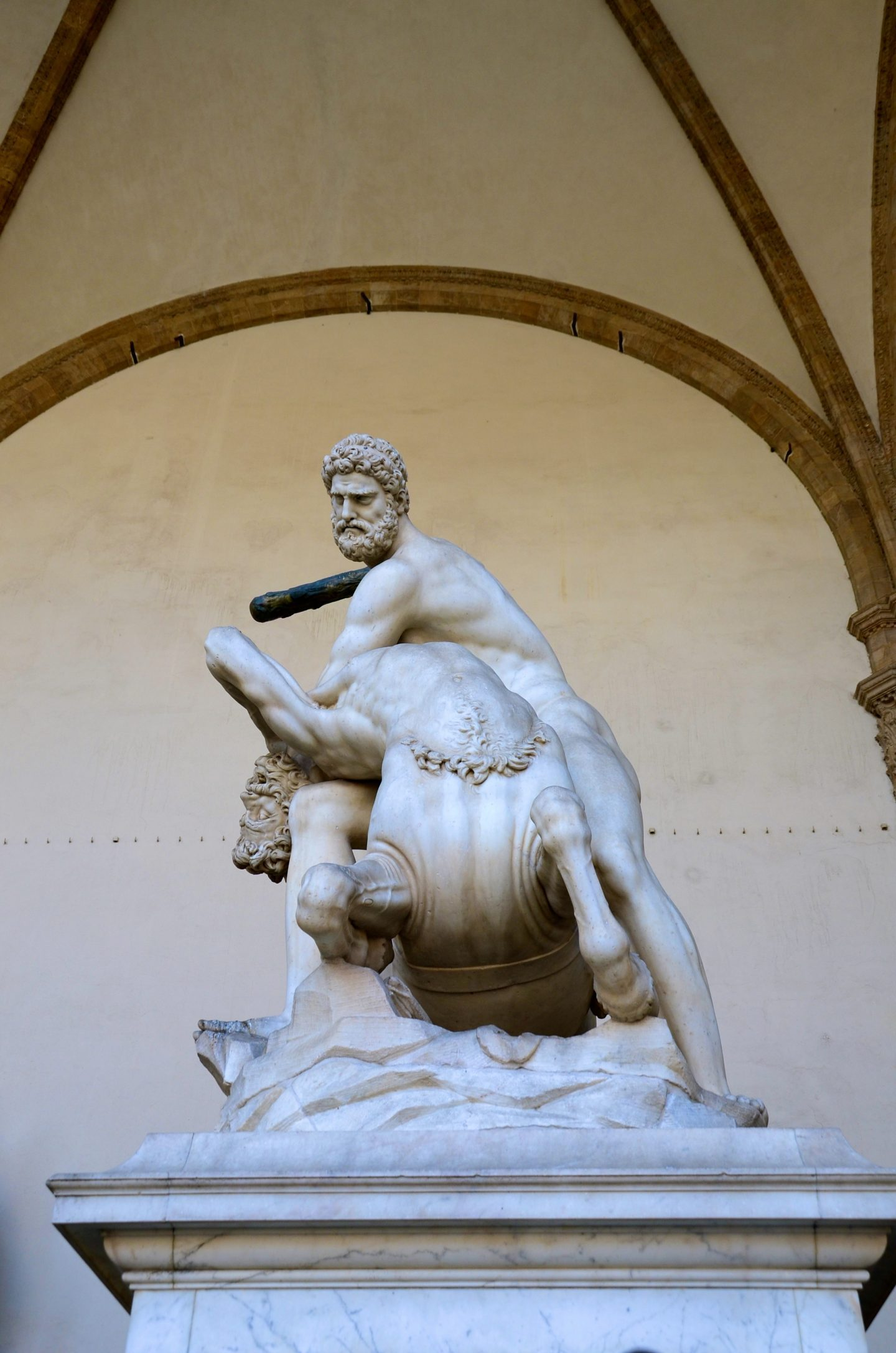 Taking a rest in front of the statue in piazza della signori a in Florence.