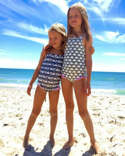 Girls posing for a photo on the beach in Nantucket.