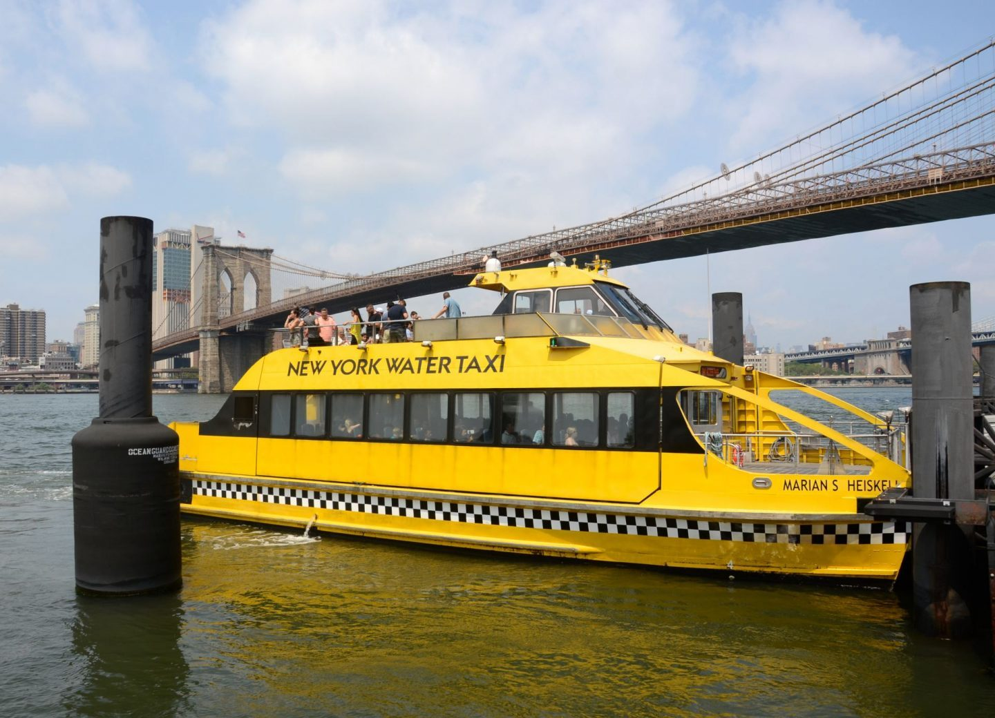 New York Water taxi next to the Brooklyn Bridge.