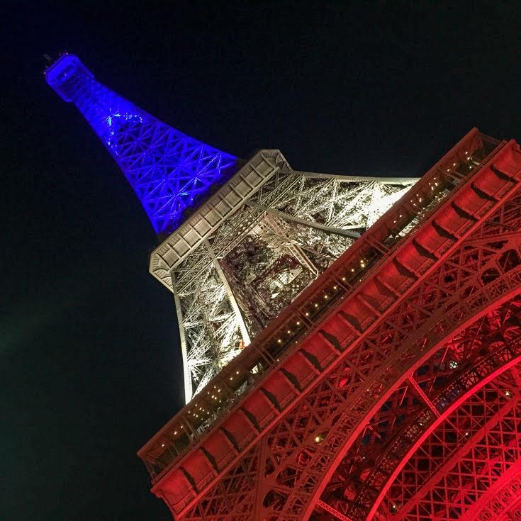 View of Eiffel Tower in Paris in red, white and blue.