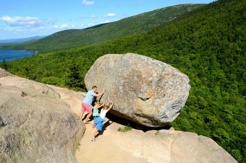 Hiking up to Bubble Rock in Acadia National Park for a summer family vacation.