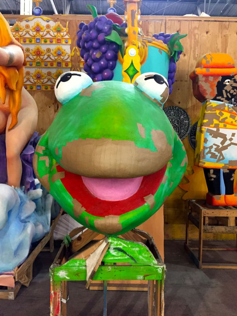 Admiring the Kermit the Frog float at Mardi Gras World in New Orleans.