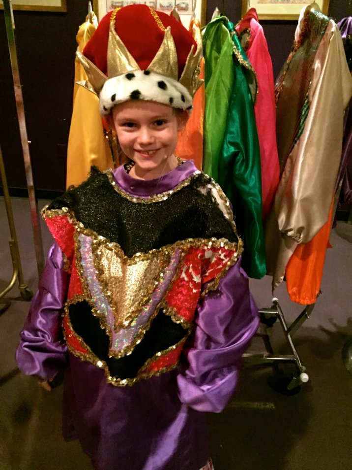 Trying on costumes at Mardi Gras World in New Orleans
