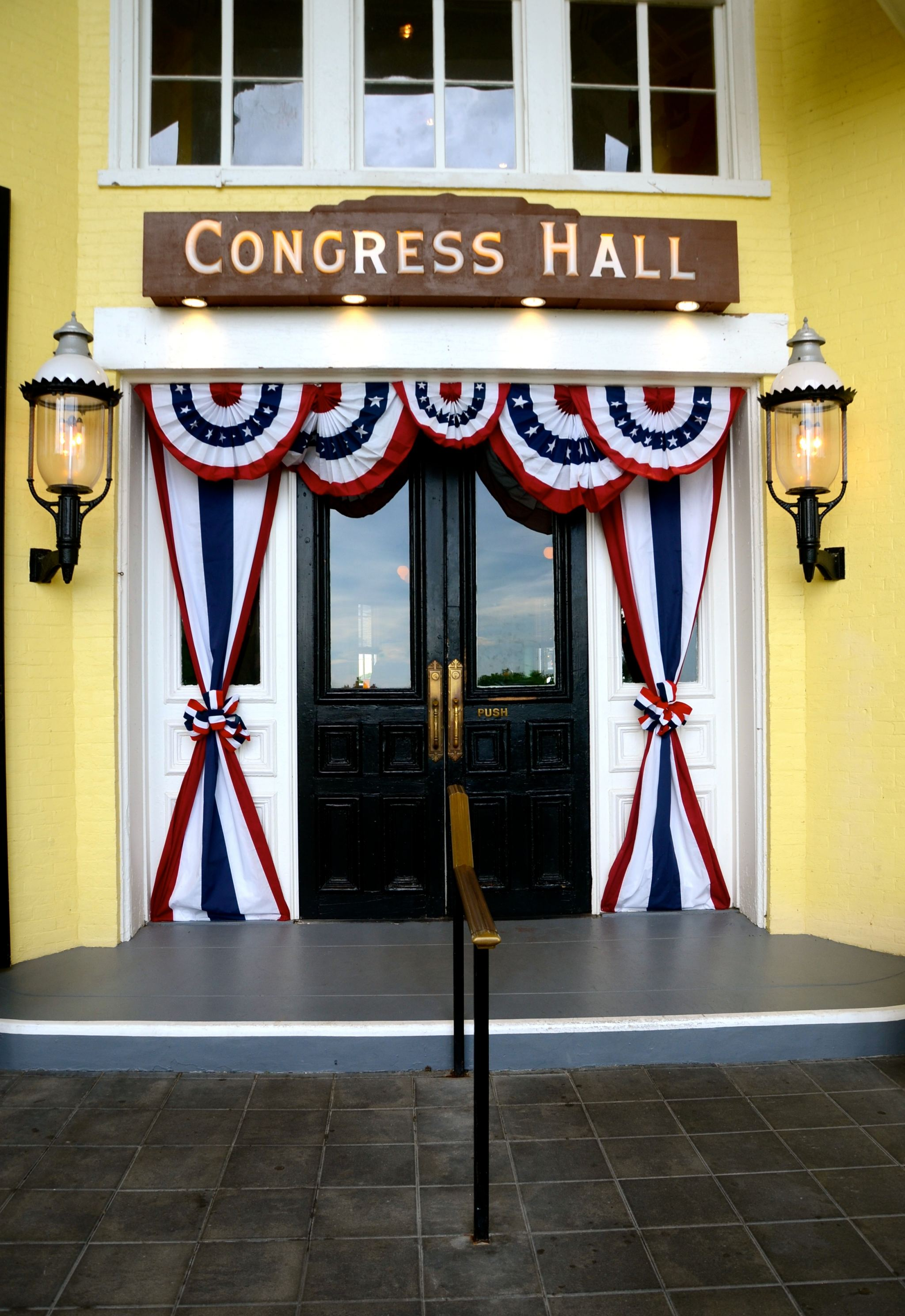 Congress hall hotel's entrance in Cape May, NJ with Independence Day decor.