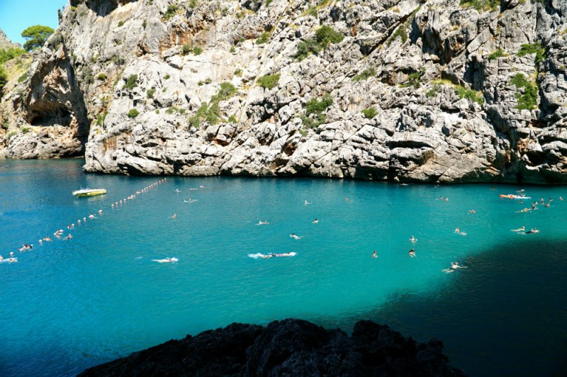 Swimming at Sa Calobra beach in Western Mallorca.