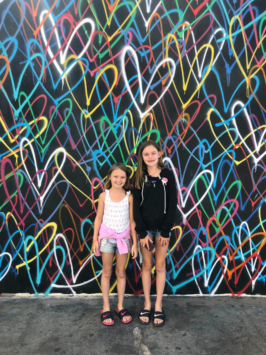 Looking at the Venice Beach street art with kids