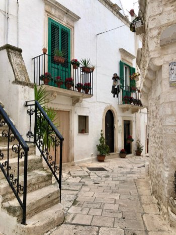 The white washed buildings and green shutters of Locorotondo