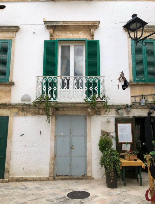 Green shutters of Locorotondo in Puglia, Italy