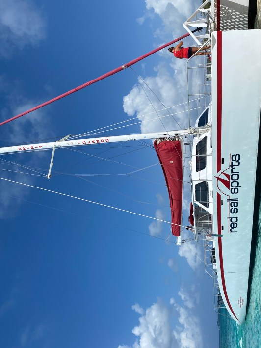 Red sail Sports Catamaran in Grand Cayman