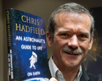 """EDS NOTE: A FILE PHOTO Canadian astronaut Chris Hadfield holds a copy of his book """"An Astronaut's Guide to Life on Earth"""" in Montreal on November 27, 2013. THE CANADIAN PRESS/Ryan Remiorz"""