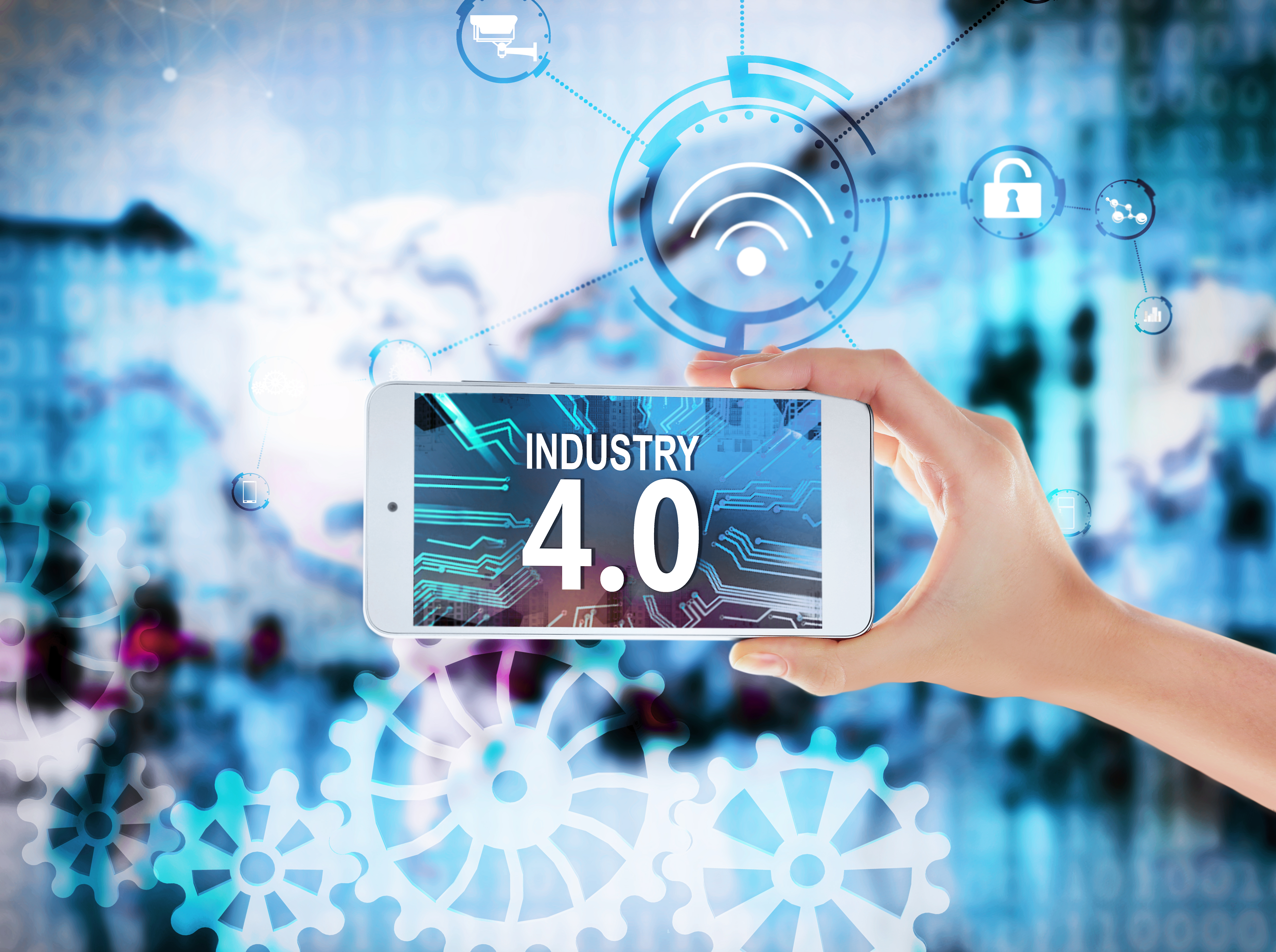 Female hand with smartphone saying Industry 4.0